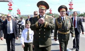 Alexander Lukashenko, centre, attends the independence day parade in Minsk