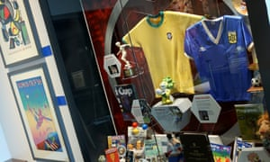 A Brazil shirt worn by Rivelino in the 1970 World Cup final and the blue Argentina shirt worn by Maradona against England in the 1986 quarter-final, on display at the National Football Museum, Manchester.