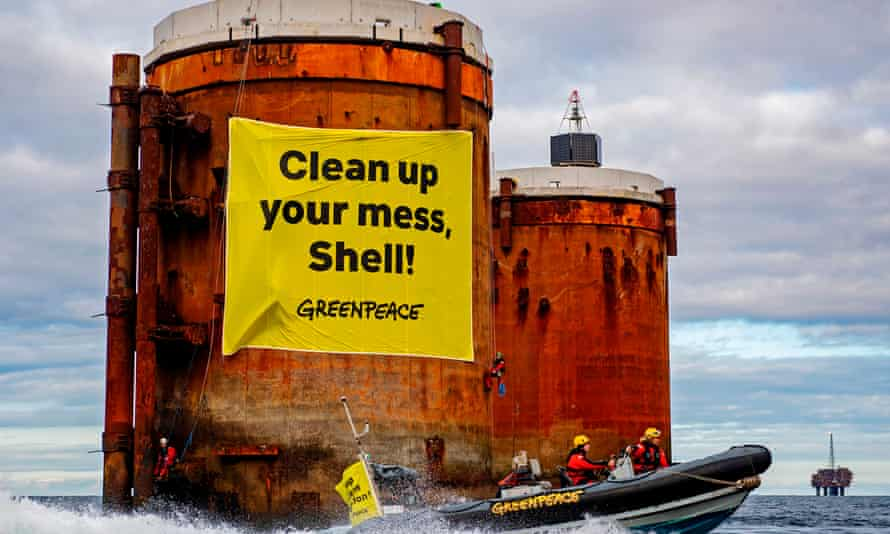 Greenpeace activists hang banners from two oil platforms in Shell's Brent field in the North Sea.
