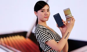 A woman presents the Galaxy Note 7 smartphone