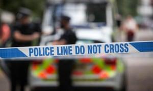 Police line tape around an investigation scene