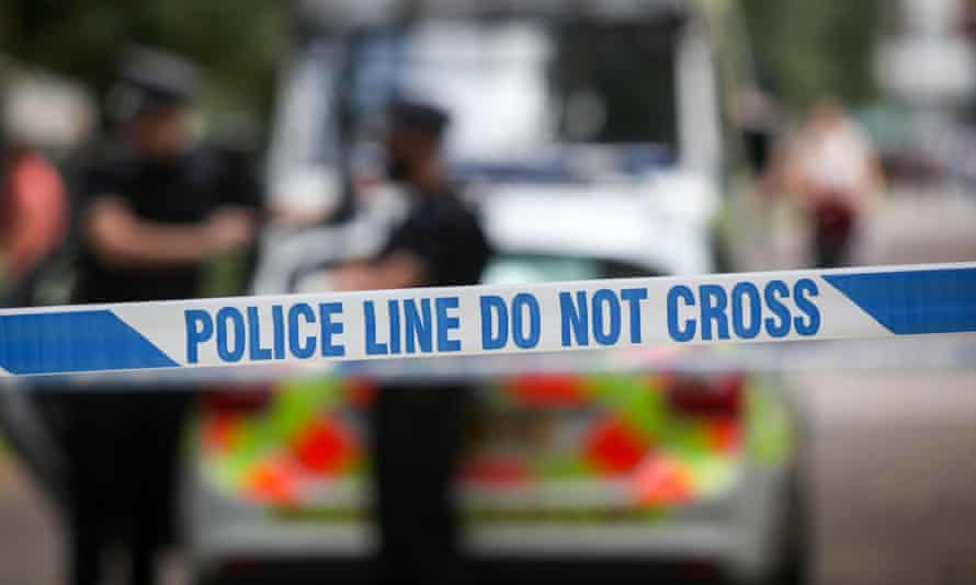 A police sign cordons off a crime scene