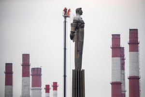 Municipal workers clean the Yuri Gagarin monument in Moscow, Russia