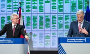 David Davis (left), the Brexit secretary, and Michel Barnier, the EU's chief Brexit negotiator, at their news conference. On a screen behind them are projected pages from the colour-coded draft withdrawal agreement, with the green patches showing what has been agreed.