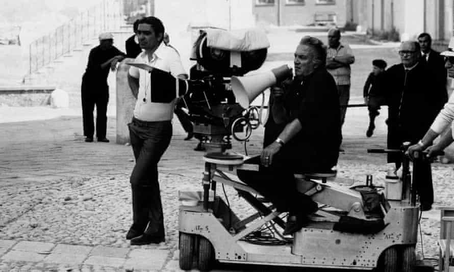 Giuseppe Rotunno, left, and Federico Fellini, centre seated, on a film set in 1973.