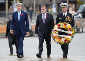 Secretary of State John Kerry, Canadian Foreign Minister John Baird and US Naval Attache, Capt. Charles J Cassidy walks forward to place a wreath at the Tomb of the Unknown Soldier during a ceremony at the National War Memorial in Ottawa