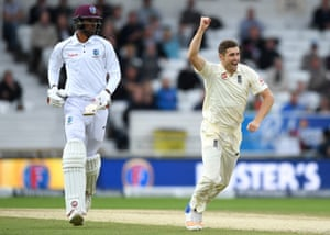 Chris Woakes of England celebrates dismissing Roston Chase of the West Indies.
