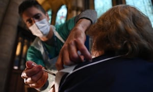A doctor administers the Pfizer-BioNTech inoculation at a vaccination centre in Salisbury Cathedral on 20 January.