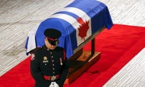 A guard stands in front of the casket of former Toronto mayor Rob Ford.