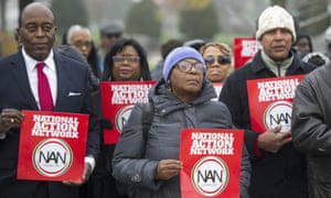 Members of the National Action Network demonstrate outside the supreme court as it heard oral arguments in Fisher v University of Texas at Austin.