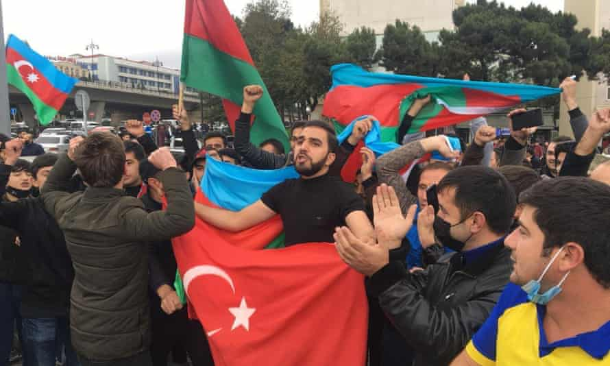 Azerbaijani people celebrate in Baku after the president claimed his country's forces had taken Shusha