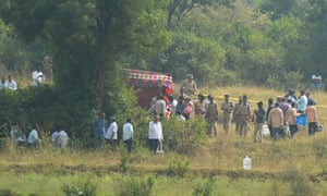 Police at the scene in Shadnagar where four rape suspects were shot dead