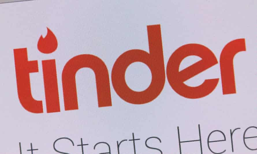 Using the Tinder online dating app on iPhone smart phone.