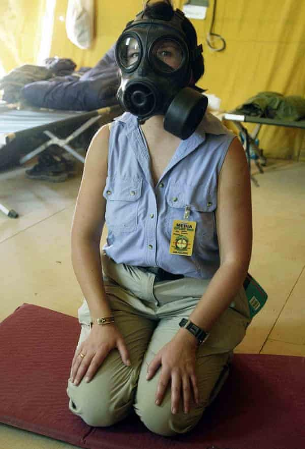 Audrey Gillan wearing a gas mask in a camp in Kuwait