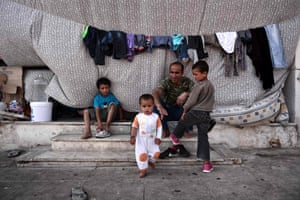 Athens, Greece A family sit in a makeshift camp hosting mainly Afghan refugees, at the former Hellinikon airport in Athens' southern suburb. More than 3,500 refugees have been staying at the Hellinikon Olympic Complex since the closure of the migrant route through the Balkans in February