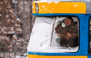 A man looks out from a tram during a heavy snowfall in Sofia, Bulgaria.