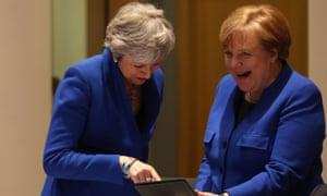 Theresa May and Angela Merkel share a joke