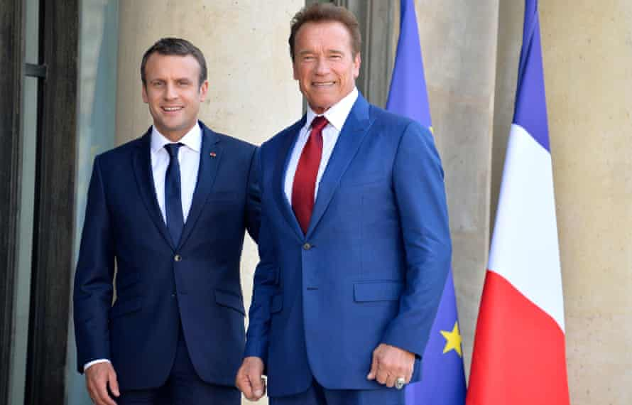 President Emmanuel Macron receives Arnold Schwarzenegger at the Elysee Palace in Paris.