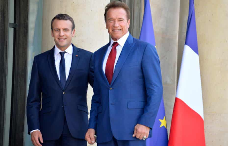 President Emmanuel Macron receives Arnold Schwarzenegger at the Elysee Palace in Paris.