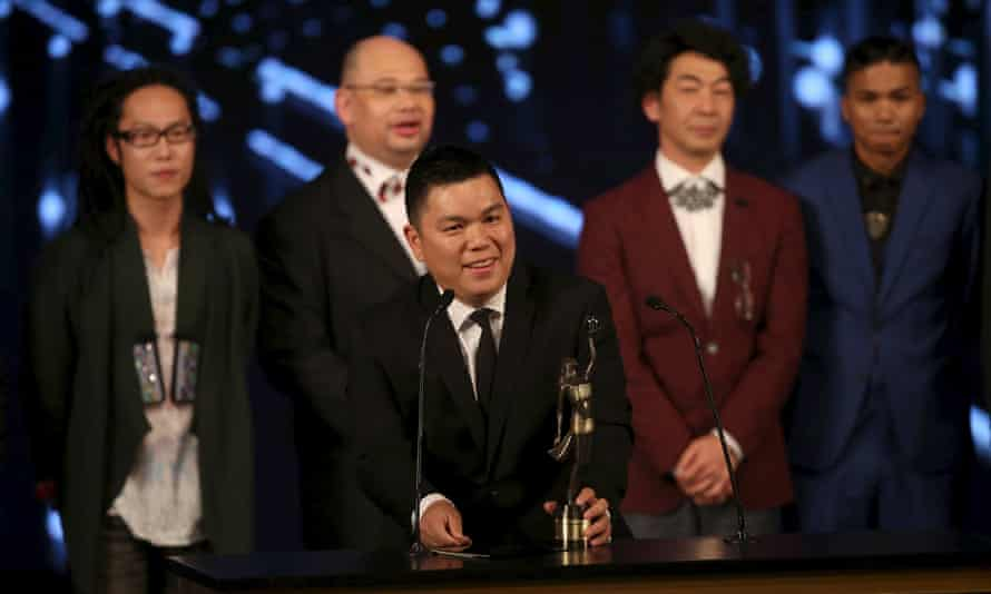 Executive producer Andrew Choi speaks in front of directors and cast members of movie Ten Years after winning best film at the Hong Kong film awards.