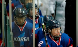 The Unified Korean team walk out onto the ice at the start of the match