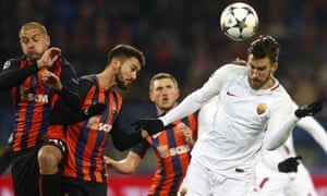 Roma's Kevin Strootman, right, gets his head to the ball.