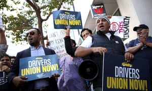 Protesters rally outside Uber headquarters in San Francisco in August in support of a California assembly bill to organise a union for rideshare drivers.