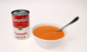 Can of Campbell's tomato soup with bowl of tomato soup in it on white background cutout.BD3767 Can of Campbell's tomato soup with bowl of tomato soup in it on white background cutout.