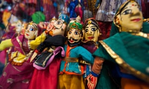 Colorful puppets hanging in a shop in Udaipur