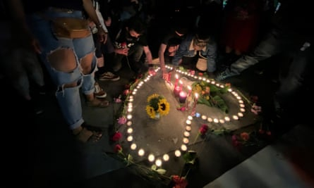 A candlelit vigil in Seattle for Summer Taylor and Diaz Love after the freeway incident