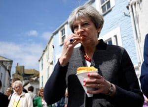 May eats some chips during a campaign stop in Mevagissey, Cornwall in 2017