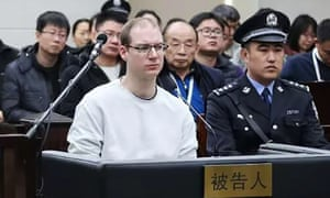 Canadian Robert Schellenberg (centre) has been sentenced to death in China over drugs charges.
