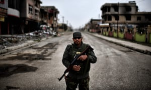 A member of the Nineveh Plain Protection Units, a Christian militia charged with protecting the town of Qaraqosh, Iraq.