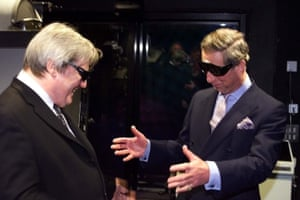 The Prince of Wales (R) jokes with film director Alan Parker wearing 3D glasses at the opening of the British Film Institute's IMAX cinema in Waterloo, London, 1999