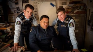 Three police officers smiling at the camera