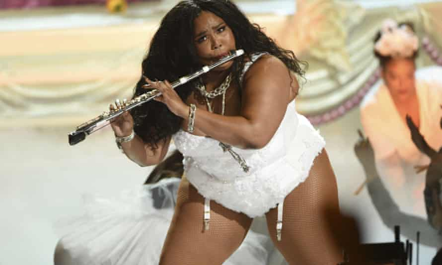 Lizzo plays the flute at the BET Awards in Los Angeles.