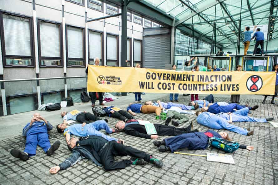 Doctors stage a die-in outside the Department for Business, Energy and Industrial Strategy in central London.