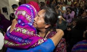 Human rights activist Rosalina Tuyuc embraces a victim of sexual violence moments after a judge read the guilty verdict in Guatemala City on Friday.