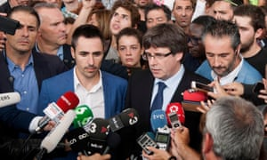 The Catalan president, Carles Puigdemont (third from left), arrives at a school in Girona where he was unable to vote after the police seized the ballot boxes