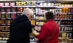 Shoppers in the dessert aisle in the Aberystwyth branch of Marks & Spencer.