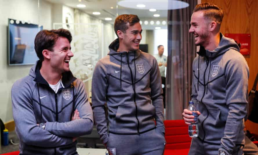 James Maddison shares a joke with Tottenham's Harry Winks and his Leicester team-mate Ben Chilwell at St George's Park.