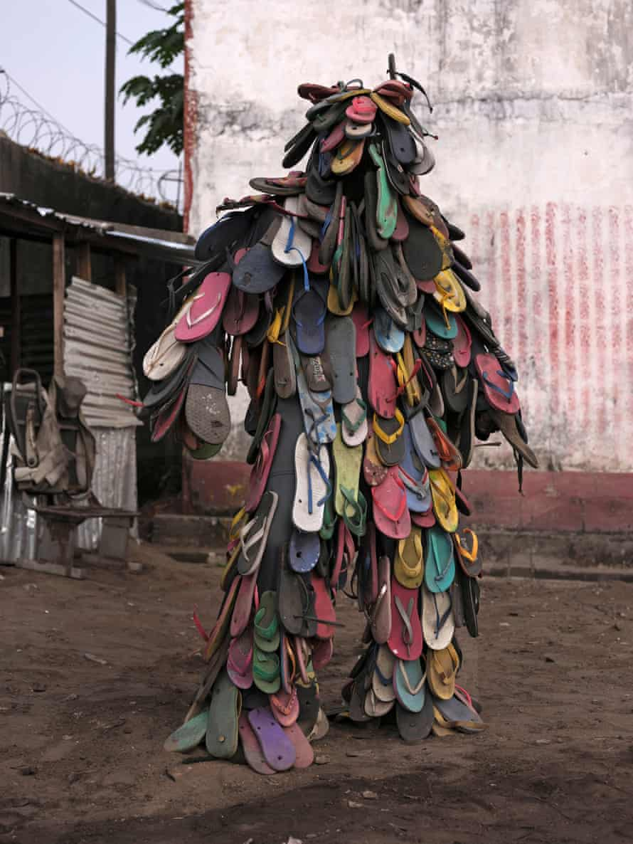 Patrick Kitete in a costume made from flip-flops found on the streets of Kinshasa.