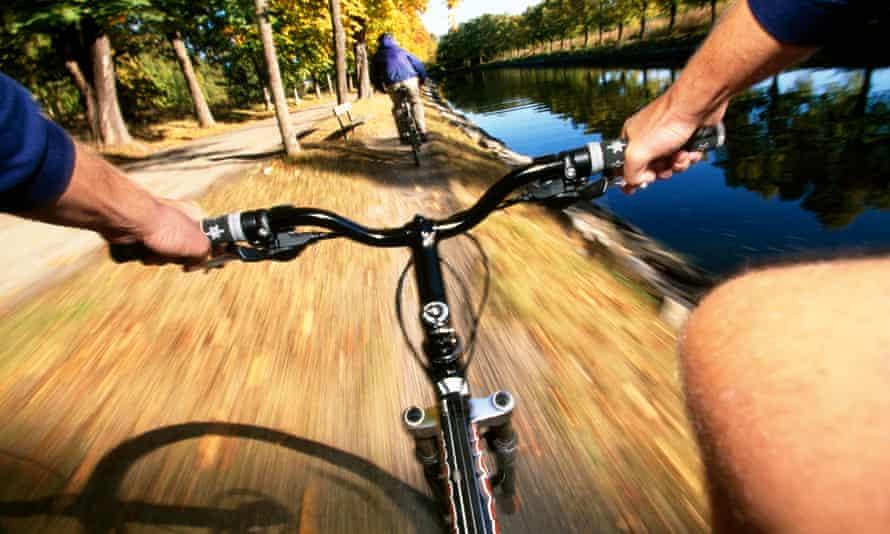 men bikes canal