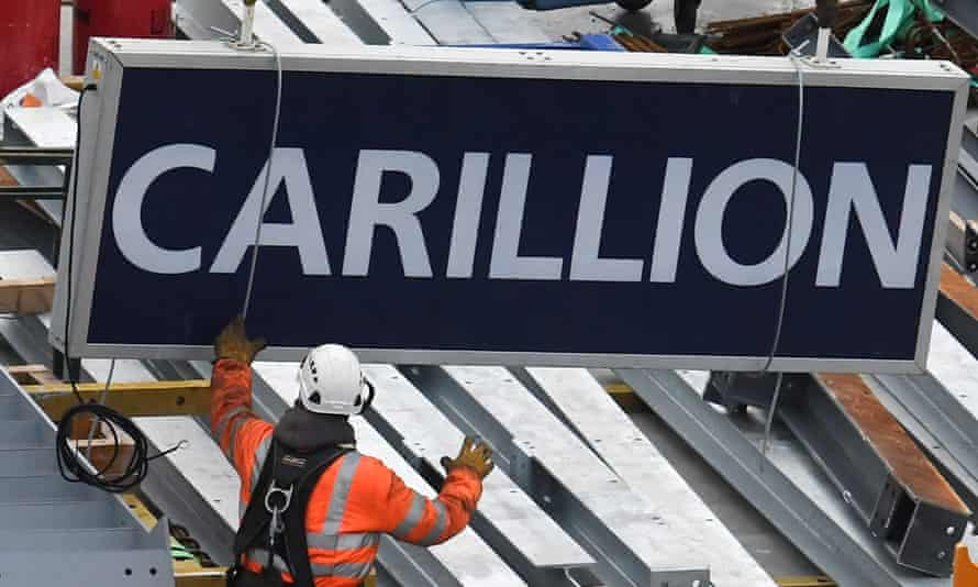 A Carillion sign is taken off a construction crane