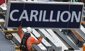 A Carillion sign is removed from a building site in London.