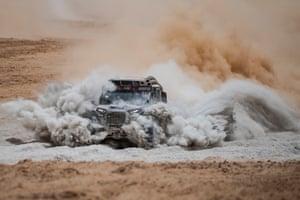 Xtremeplus Polaris driver Maciej Domzala and co-driver Rafal Marton kick up a bit of dust