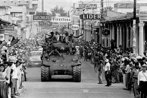 Santa Clara, 1959.  Castro's revolutionary troops with captured tanks riding into the Cuban city previously liberated by fellow revolutionary Ernesto Che Guevara