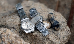 Wristwatches found at the site of a landslide site caused by heavy rain in Kumano, Japan.
