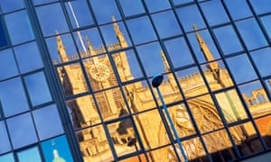 Holy Trinity Church, Hull, reflected in a glass-fronted office block.