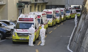 Ambulances carrying patients infected with the novel coronavirus arrive at a hospital in Daegu, South Korea.